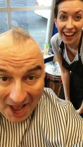 Leo finally gets darn close to shaving his head.